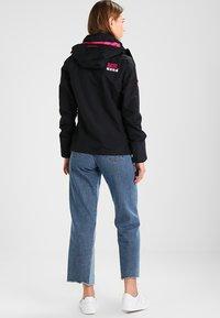 Superdry - TECH HOOD POP ZIP WINDCHEATER - Summer jacket - black/raspberry - 2