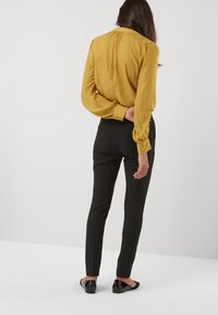 Next - SLIM TROUSERS - Trousers - black - 2