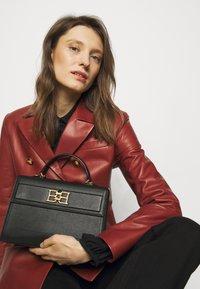 Bally - CHAIN TO HANDLE BAG - Handbag - black - 0