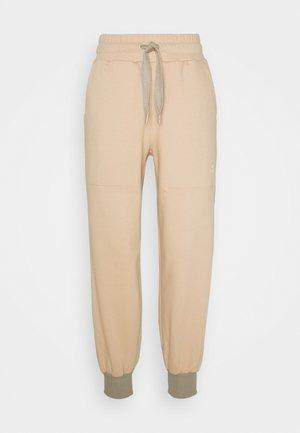 Pantalones deportivos - soft powder/light brown