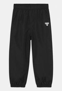 Hummel - TARO UNISEX - Rain trousers - black - 0