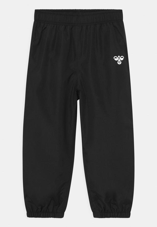 TARO UNISEX - Pantalones impermeables - black
