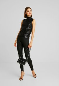 Gina Tricot - EXCLUSIVE HOLLY GLITTER - Blouse - black - 1