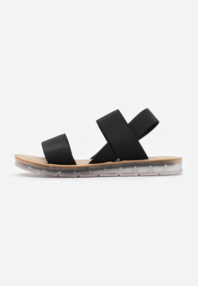 PENNY - Sandaalit nilkkaremmillä - black
