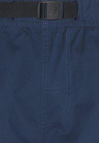 New Balance - ATHLETICS PANT - Trousers - dark blue - 2