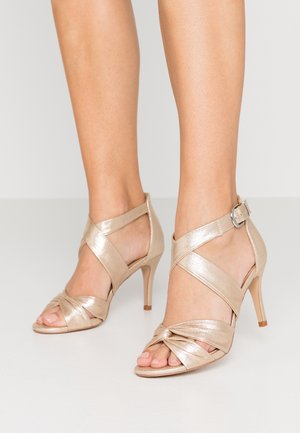 STARBRIGHT - High heeled sandals - gold