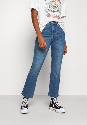 YLVA KICK FLARE  - Flared jeans - mid blue