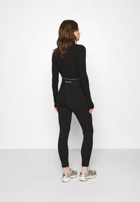 Calvin Klein Jeans - MILANO LOGO ELASTIC - Legging - black - 2