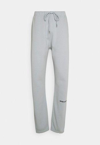 LOGO PANTS UNISEX - Tracksuit bottoms - pantone grey
