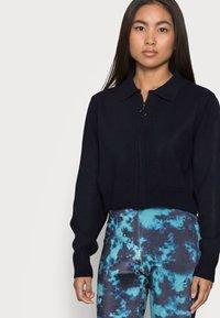 Topshop Petite - TIE DYE FLARE - Trousers - blue - 3