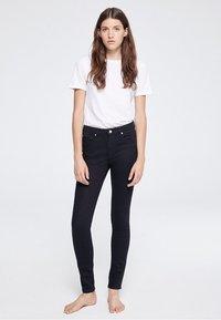ARMEDANGELS - TILLY - Slim fit jeans - rinse black - 1