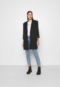 Calvin Klein Jeans - ROUND TEE - Print T-shirt - white - 1