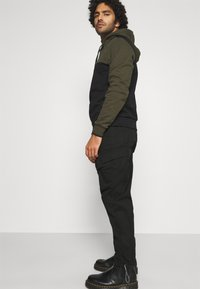 Calvin Klein Jeans - TECHNICAL - Cargo trousers - black - 3