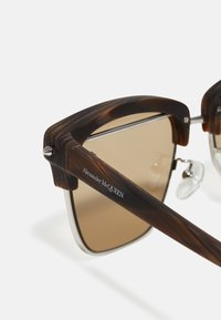 Alexander McQueen - UNISEX - Sunglasses - silver-coloured/brown