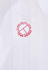 adidas Performance - FREELIFT - Sports shirt - white/scarlet - 2