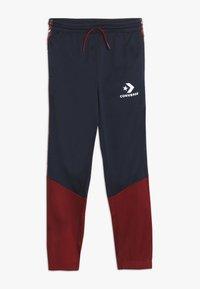 Converse - STAR CHEVRON COLORBLOCK TAPING TRACK PANT - Pantaloni sportivi - obsidian - 0