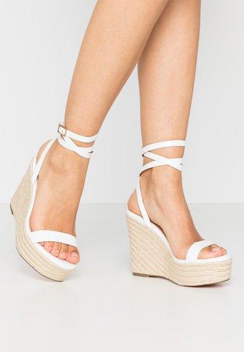 High heeled sandals - white