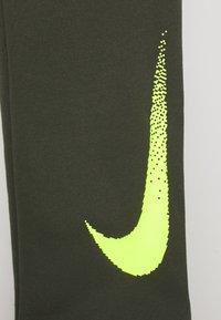 Nike Performance - DRY PANT - Tracksuit bottoms - cargo khaki/volt - 2