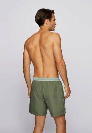 STARFISH - Swimming shorts - open green