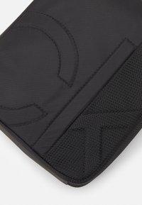 Calvin Klein - REPORTER UNISEX - Across body bag - black - 4
