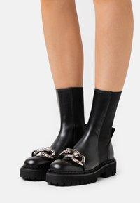 N°21 - BOOTS - Platform ankle boots - black - 0