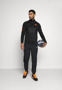 Nike Performance - AS ROM - Club wear - black/safety orange - 1