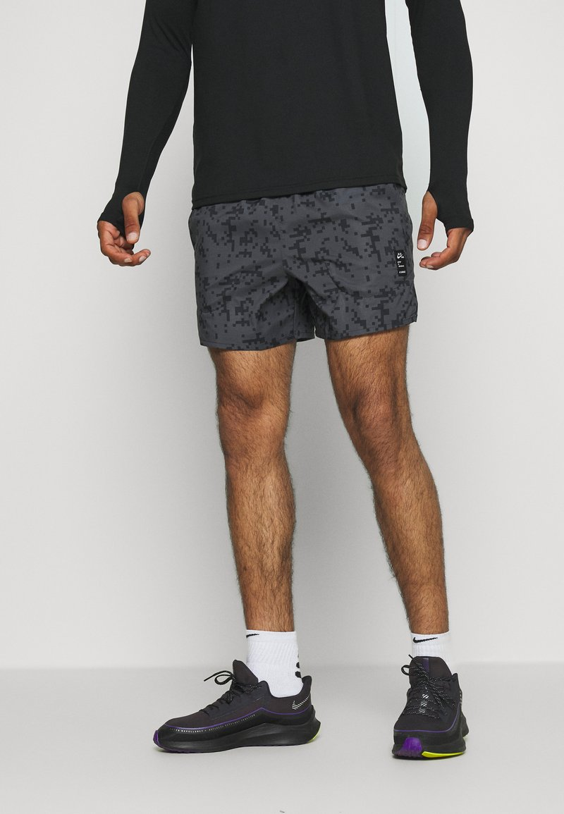 Nike Performance - FLEX STRIDE SHORT ART - Sports shorts - black