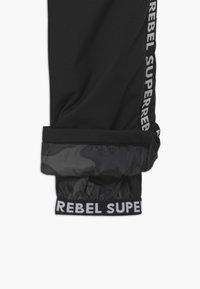 SuperRebel - SUSTAINABLE PLAIN - Zimní kalhoty - black - 4