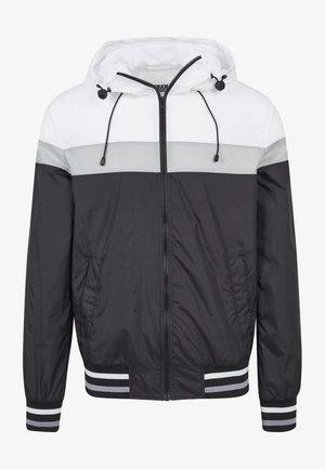 HOODED COLLEGE WINDBREAKER - Summer jacket - black/white/grey