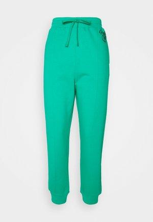 BUGS PANTALONE - Teplákové kalhoty - verde esmeraldo