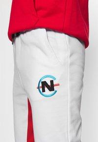 NAUTICA COMPETITION - PARREL - Tracksuit bottoms - white - 3