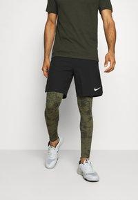 Nike Performance - Leggings - medium olive/white - 0
