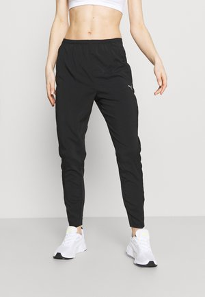 RUN TAPERED PANT - Verryttelyhousut - black