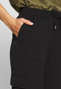 ONLY - ONLNEVIE SONJA LIFE  STRING PANT - Trousers - black - 4