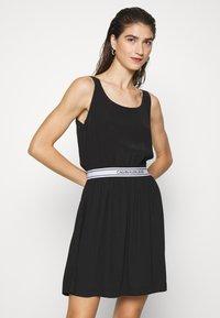 Calvin Klein Jeans - LOGO DRESS - Day dress - black - 0