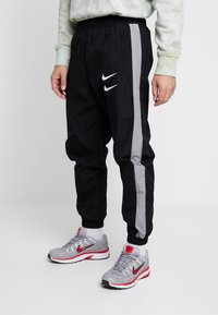 Nike Sportswear - Träningsbyxor - black/particle grey/white - 0