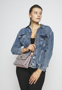 Calvin Klein - RE LOCK CROSSBODY - Across body bag - pink - 1
