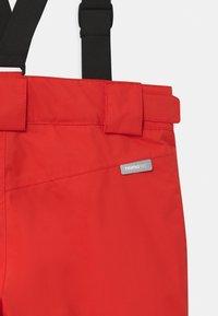 Reima - WINTER TAKEOFF UNISEX - Zimní kalhoty - tomato red - 6