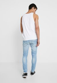 Pier One - Jeans slim fit - bleached denim