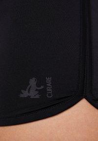 Curare Yogawear - YOGA SHORTS - Leggings - black - 4