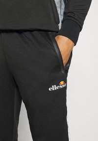 Ellesse - LOBIAT - Tracksuit bottoms - black - 4