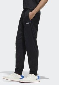 adidas Performance - ESSENTIALS JOGGER JOGGERS - Pantaloni sportivi - black - 1