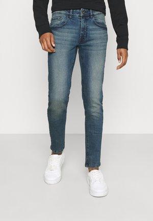 COPENHAGEN - Jeans Tapered Fit - mining blue