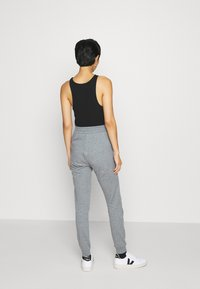 Armani Exchange - TROUSER - Tracksuit bottoms - grey heather - 2
