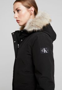 Calvin Klein Jeans - GERMANY SPECIAL PARKA - Down coat - black - 4