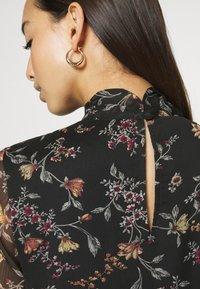 Vero Moda - VMTILI HIGH NECK SHORT DRESS - Day dress - black/tiny - 5