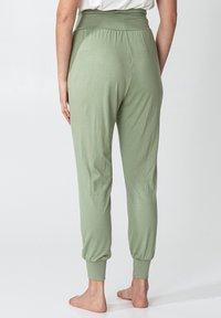 Indiska - YOGA - Tracksuit bottoms - green - 2
