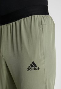adidas Performance - CITY BASE DESIGNED4TRAINING SPORT PANTS - Pantaloni sportivi - green - 3