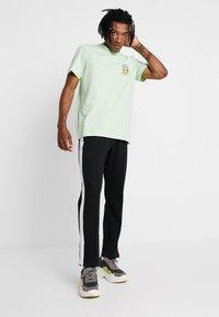 adidas Originals - BODEGA POPSICLE - Print T-shirt - glow green - 1