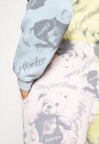 NEW girl ORDER - BEAR PANEL - Tracksuit bottoms - multi - 4